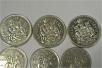 Three .50 Cent Pieces
