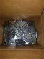 Box lot of Larson Juhl metal hanging mounts