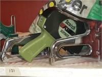 Lot of staple guns, scotch dispenser,