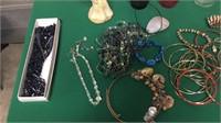 Plates, Costume Jewelry, Milk Bottle, Candle,Etc.