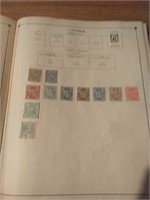 Postage stamp album with stamps inside