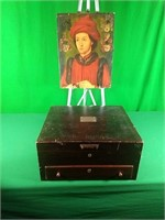 Naken's silverware chest and picture on wooden