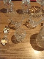 2 glass candlestick holders, glass creamer and