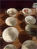 15 saucers, 10 teacups, 8 sugar bowls, and 3