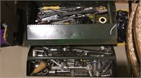 Green metal tool box with tools, pull out tray