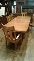 9' table with 3 leaves and 6 chairs