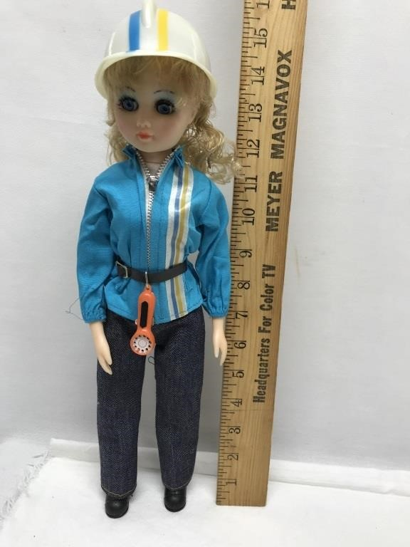 A & M 1980 doll bell telephone repair woman doll   Ogle Auctions