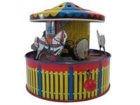 TIN WIND-UP MERRY-GO-ROUND WITH THREE HORSES