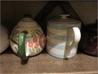 Three shelves of tea pots
