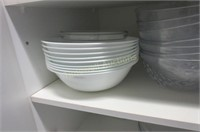 Two shelves of serving dishes