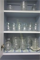 Cupboard full of glassware and small dishes