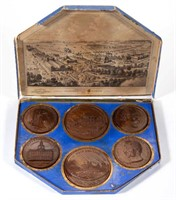 Centennial Exposition boxed set of carved wooden medals