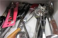 Drawer full of utensils