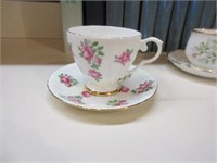 Five cups and saucers