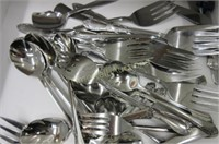 Large drawer full of miscellaneous serving spoons