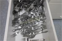 Large drawer full of forks