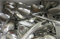 Large drawer full of large spoons