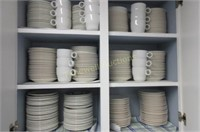 Two cupboards full of cups and saucers
