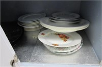Cupboard full of miscellaneous serving dishes