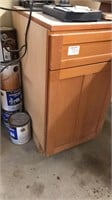 Wood cabinet 17.5 in x 24 in x 36 in contents