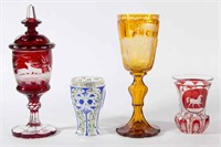 Fine engraved and cut Bohemian glass including a large amber chalice/pokal with engraving possibly done by Karl Pfohl or Franz Zach.