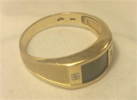 14 karat gold ring, black onyx with diamond