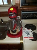 Kitchen Aid mixer with accessories and paperwork