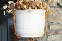Macrame hanging pot holder with white ceramic pot