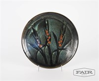 Pottery plate with abstract cattail motif