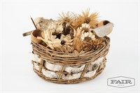 Decorative basket with dried flowers and bark