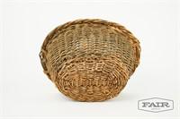 Antique basket with woven rim