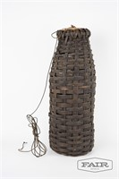 Vintage woven eel trap with stopper