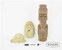 2 stone faces and 1 wooden Moai sculpture