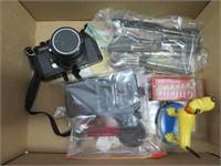 Box of cameras, silverware, razor etc.