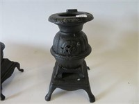 3 miniture cast wood stoves