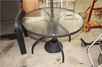 "Glass top patio table (40"" diameter) with"