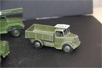 """4 Dinky Toy army trucks.  4""""-6"""""""
