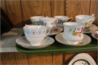8 cups and saucers