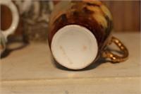 Shaving mug, pitcher and figurine