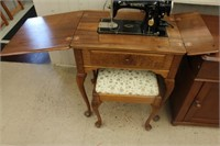 Singer cabinet sewing machine with bench