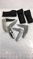 Group of stainless steel pocket knives made in