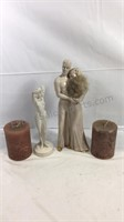 Lot of candles and two figurines