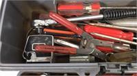 Plastic toolbox full of assortment of handtools