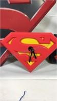 Superman umbrella, clock, hat, metal sign