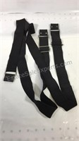 Group of four belts and seven pairs of suspenders