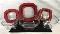 Group of three glass Rubbermaid containers with