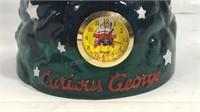 Curious George snow globe clock