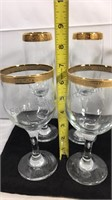 Group of gold rimmed bar glasses
