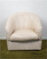 Off white leather swivel lounge chair