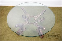 Glass top coffee table with decorative metal base